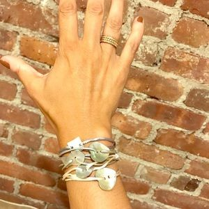 Five mother of pearl, resin and  silk bracelets